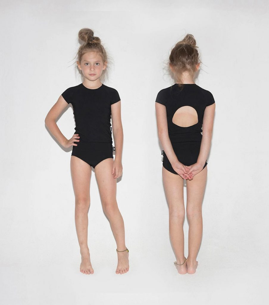 Cool black swimsuits for girls: Nununu two-piece shirtini with circle cutout