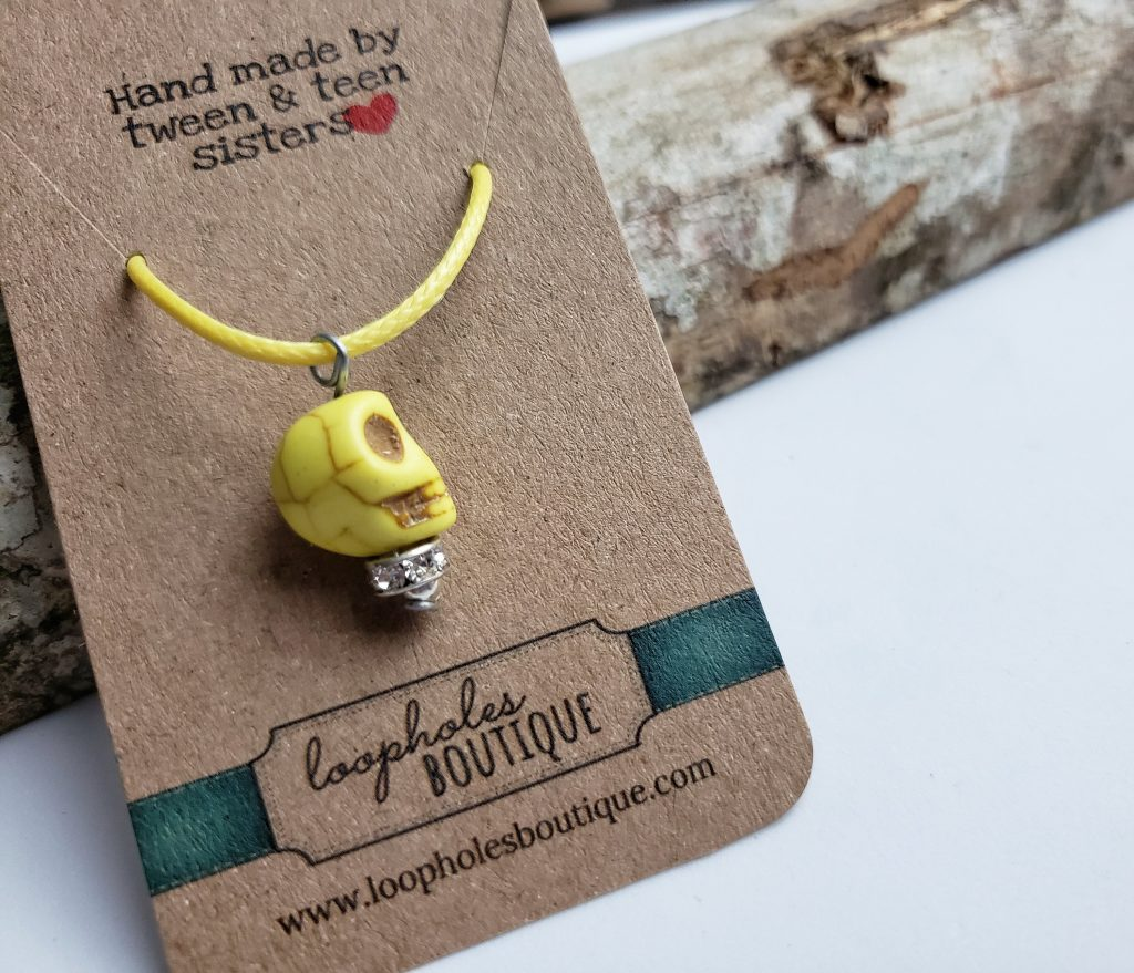 Punk yellow skull bead necklace created by two young sisters to support charities | Loopholes Boutique