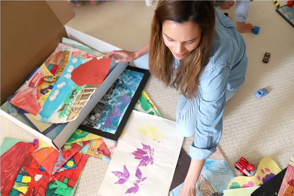 Creative ways to display kids' artwork: Use the Artkive concierge service to catalog and digitize all your kids' artwork, then turn it into a custom album!