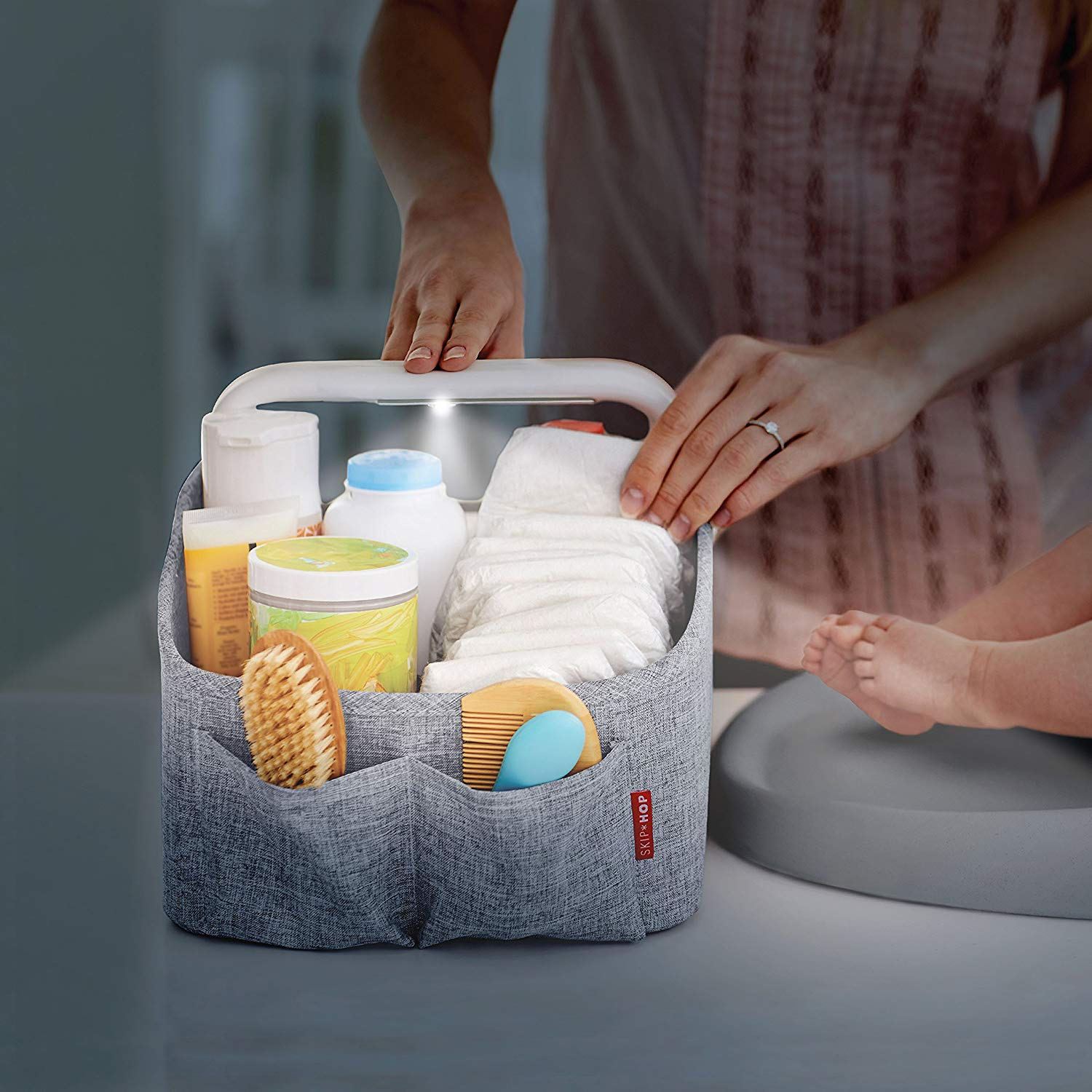 Best baby gear for twins: The Skip Hop light-up diaper caddy makes it easy to find what you need without waking up both babies.