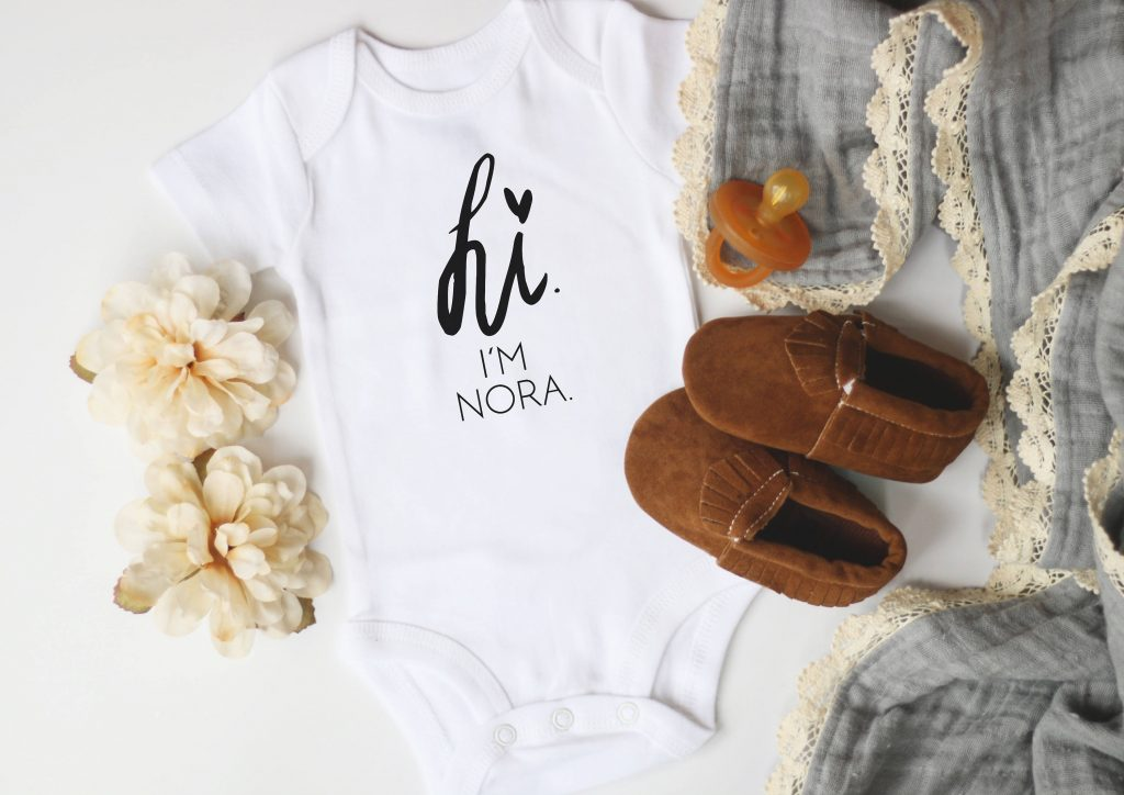 """Personalized """"hi my name is..."""" baby onesie from Kal & Co make great baby shower gifts"""