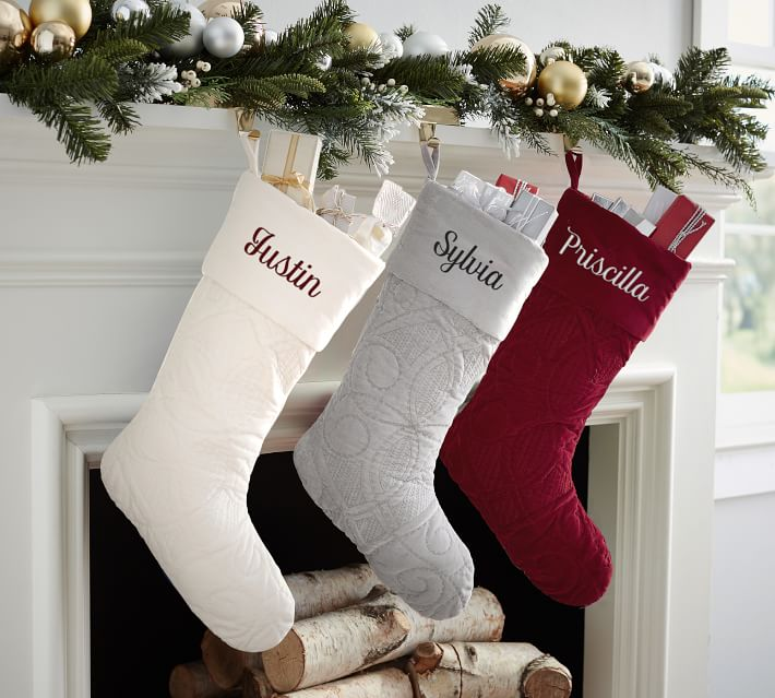 Personalized velvet Christmas stockings at Pottery Barn, now on sale