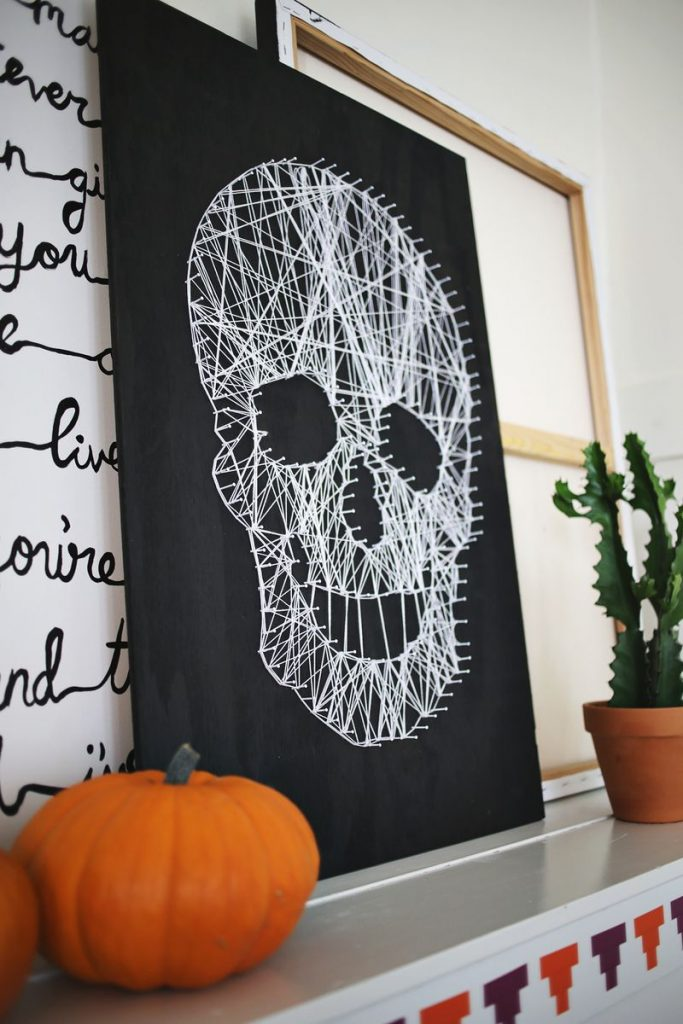 Halloween crafts for tweens and teens: Skull string art craft DIY at A Beautiful Mess