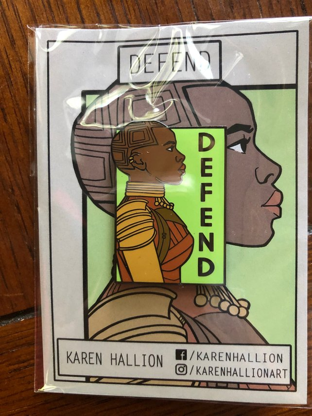 "Okoye ""Defend"" poster and pin by Karen Hallion on Etsy from her She Series of prints"
