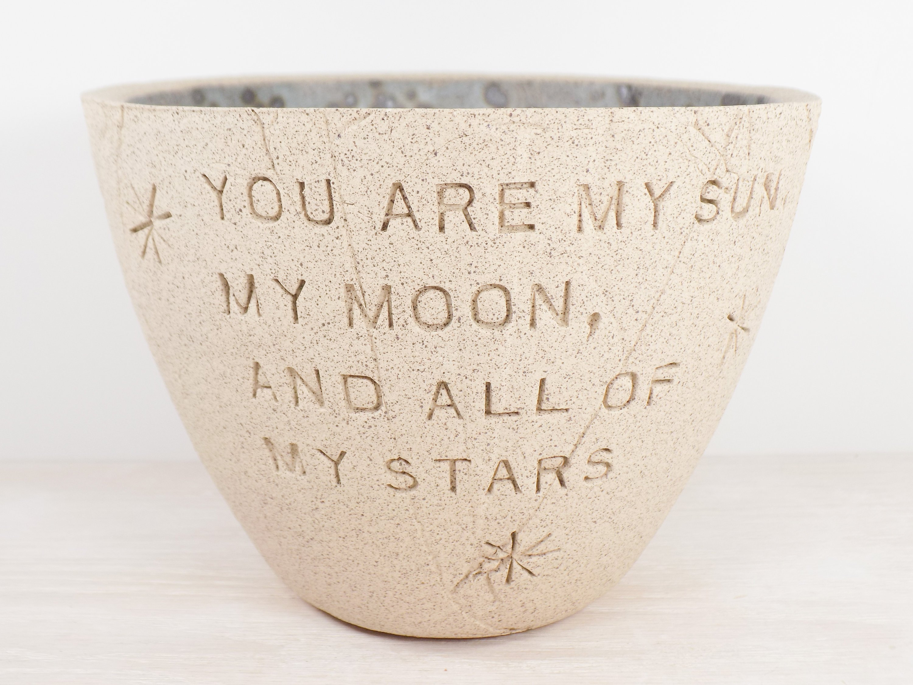 Creative personalized gifts: Custom pottery bowls with poetry lines, sayings, or names at Braidwood Pottery