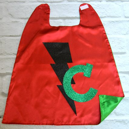 Cool kids' gifts under $15:  Personalized glitter bolt superhero cape from Sew Plain Jane