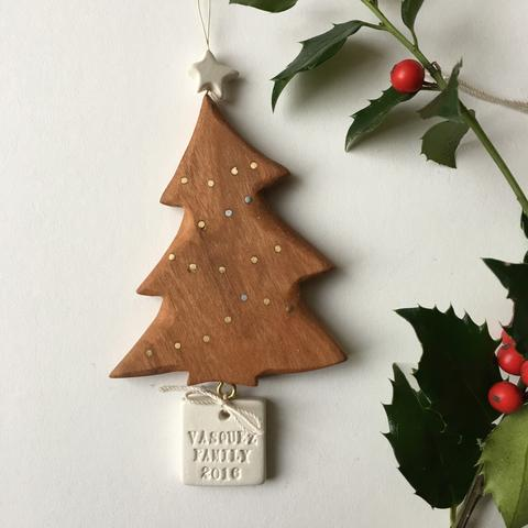 Special grandparent gifts: personalized inlaid cherry wood and ceramic tree ornament from Paloma's Nest | cool mom picks holiday gift guide