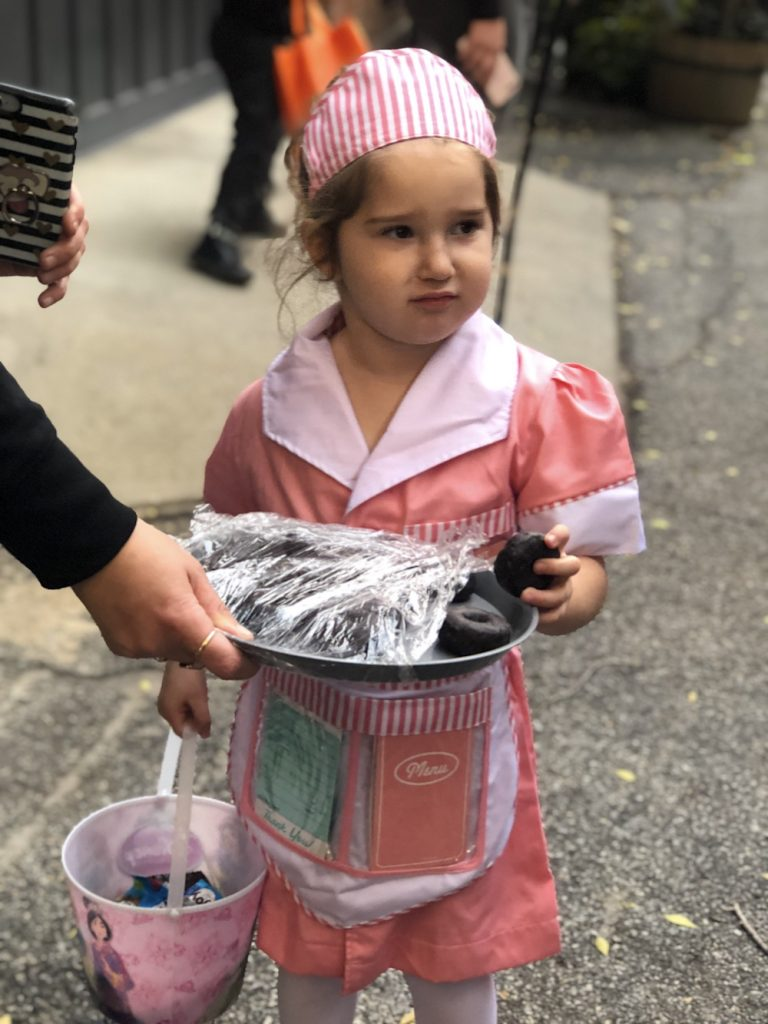Best Garden Place, Brooklyn Halloween costumes 2018: Waitress handing out donuts | © Cool Mom Picks