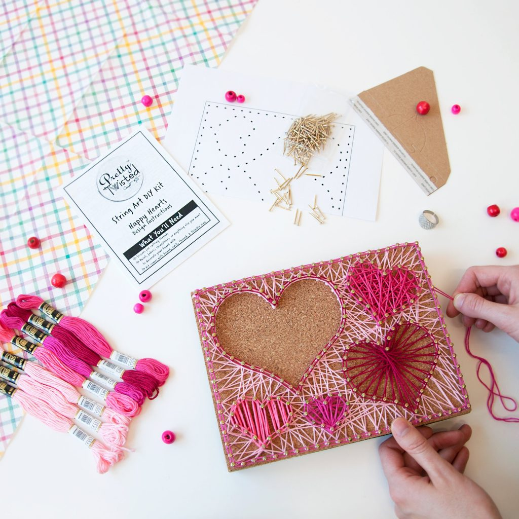 Kids can make their own gifts or room decor with Pretty Twisted string art kits in lots of styles
