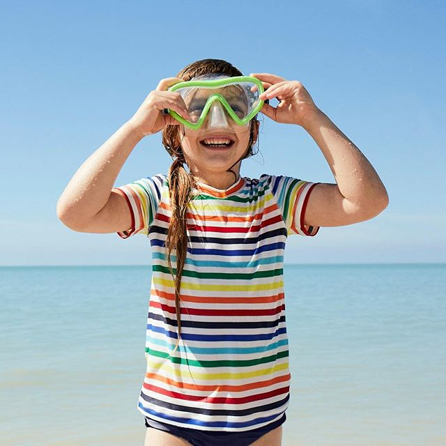 Primary swimwear for kids in solids, color blocks, and rainbow stripes - great prices, and they hold up beautifully!