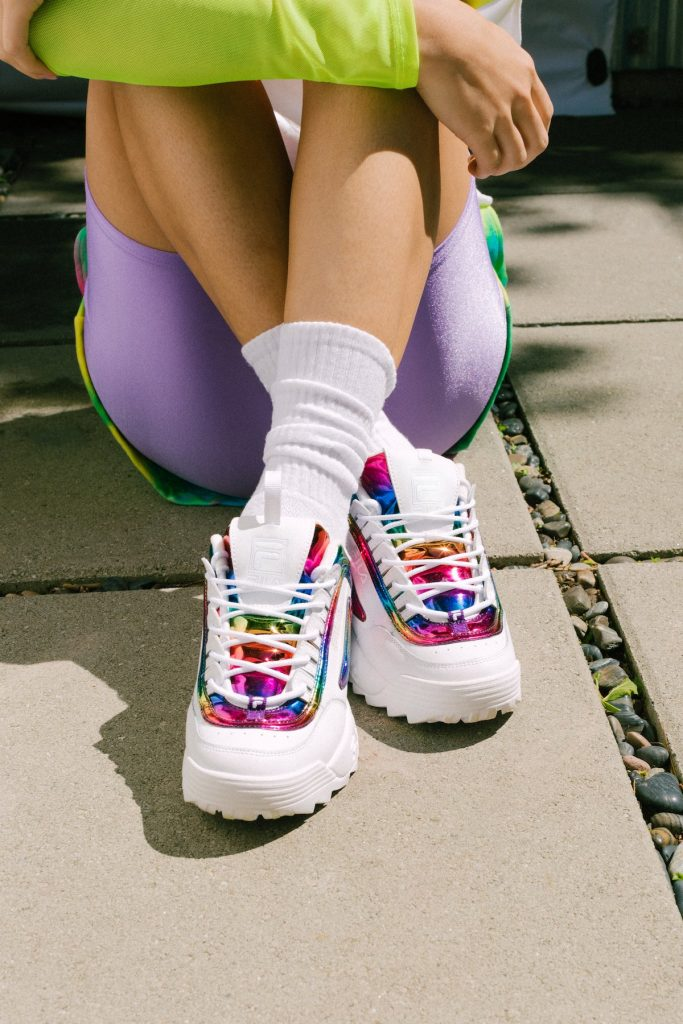 Cool pride gifts that give back: Rainbow Fila x Phluid Project sneakers