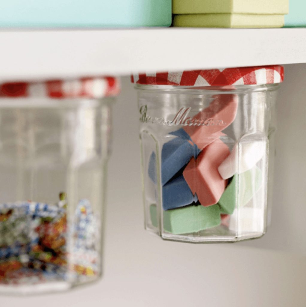 Jelly jar under-desk storage for school supplies: School supply organization hack from Lifehacks
