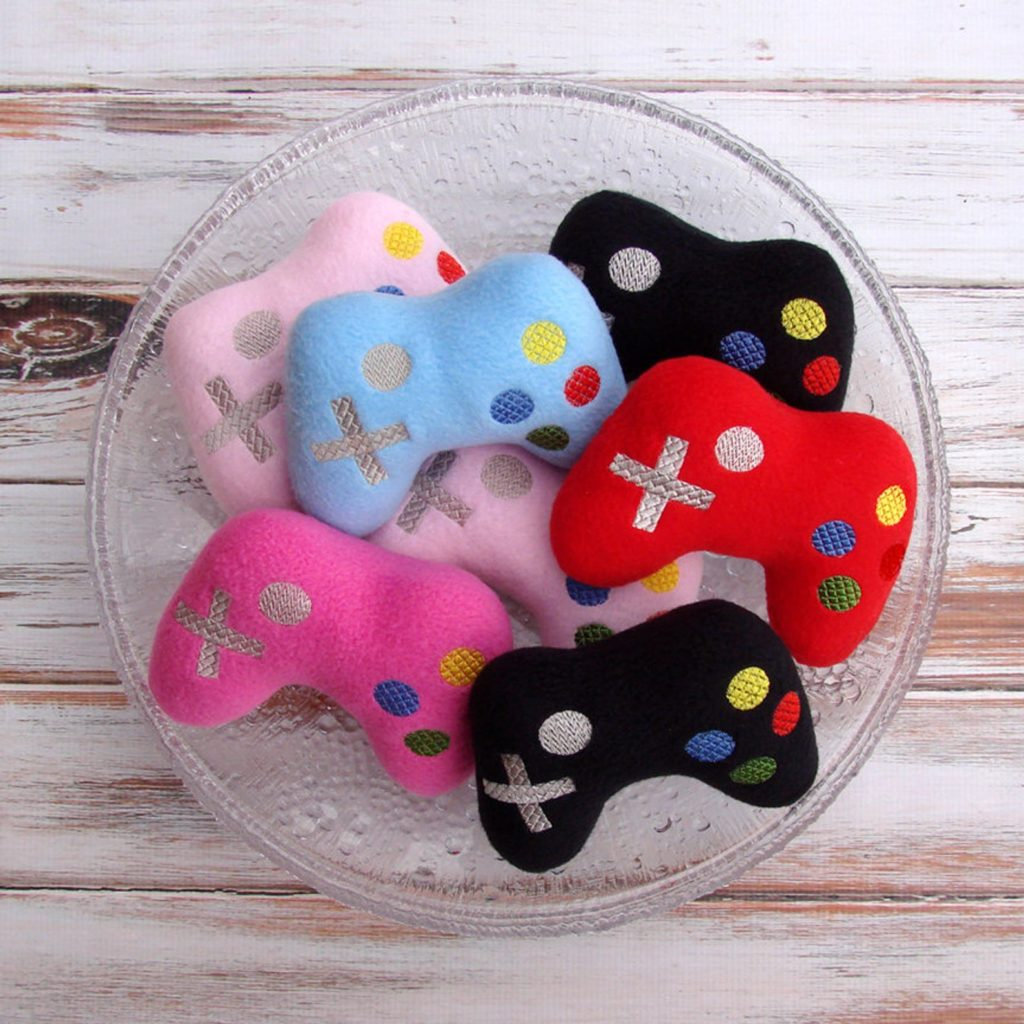 Best baby shower gifts under $15: handmade future gamer plush rattle | Cool Mom Picks Baby Shower Gift Guide