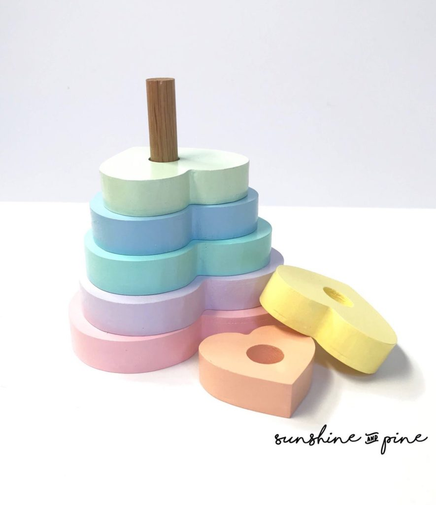 Best baby shower gifts under $50: Handmade wooden pastel rainbow heart stacker | Cool Mom Picks Baby Shower Gift Guide