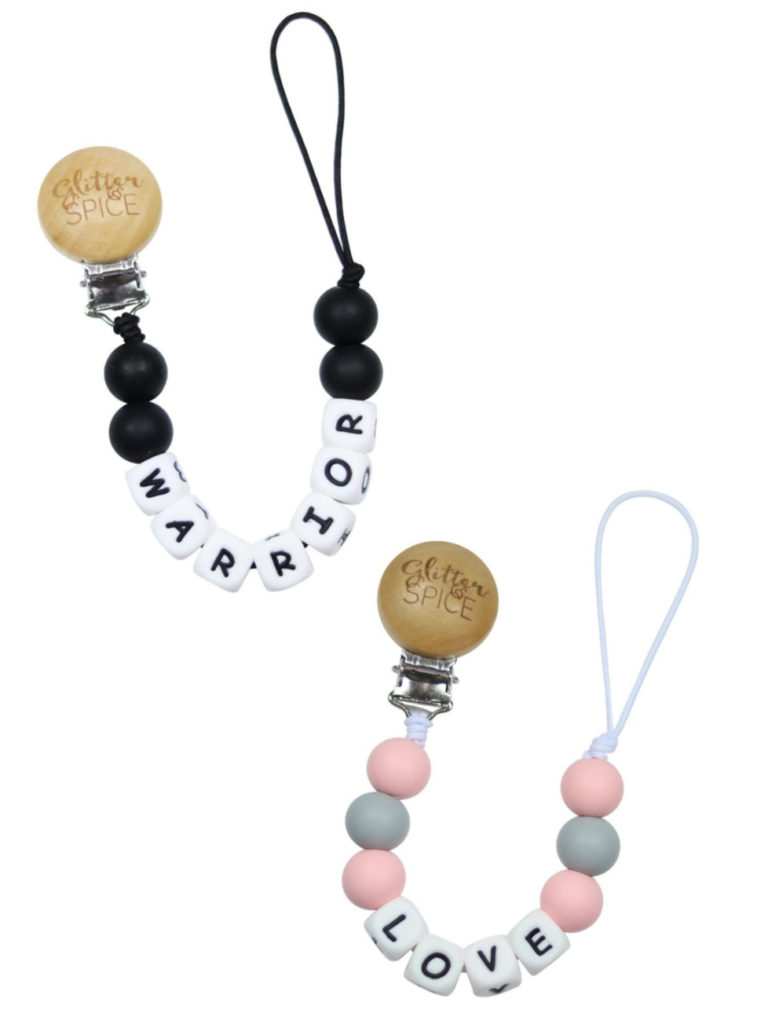 Best baby shower gifts under $15: Statement pacifier clips | Cool Mom Picks Baby Shower Gift Guide