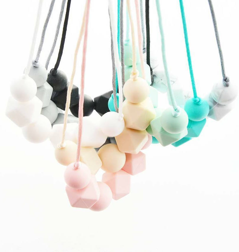 Best baby shower gifts under $15: Silicone teething necklaces | Cool Mom Picks Baby Shower Gift Guide