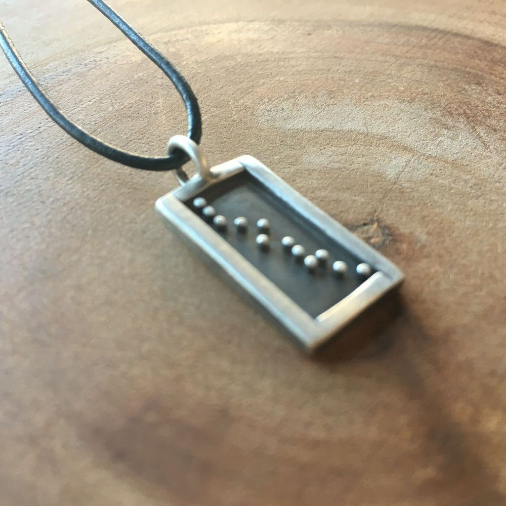 Feelthe Love Necklace from Heart & stone supporting the International Rescue Committee