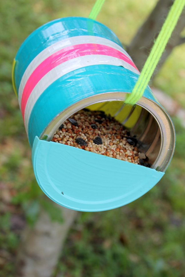 A Mother's Day craft idea from Momtastic: make a colorful bird feeder from a can