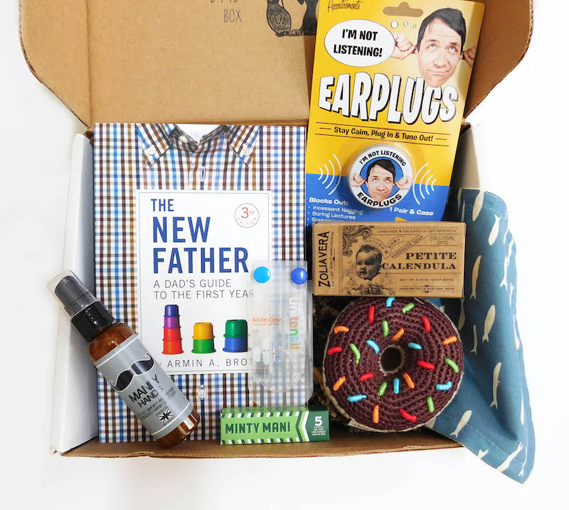 Cool subscription gifts for men: For the new dad who's loving parenthood, the Rad Dad box has a little for him and a little for your baby.