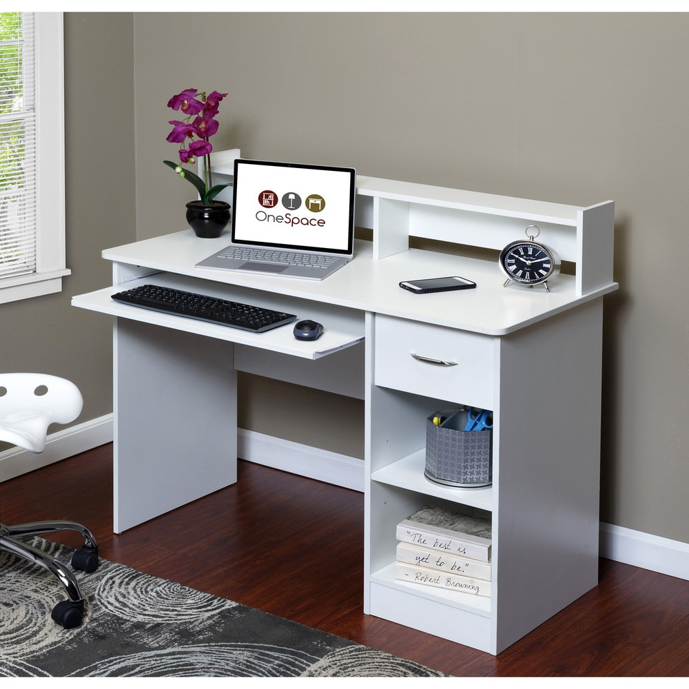 Consider your kids academic needs before picking a desk: Young kids can use art tables, while older kids with more computer time during the school day need a compact computer desk like this one, affordable at Overstock (sponsor)
