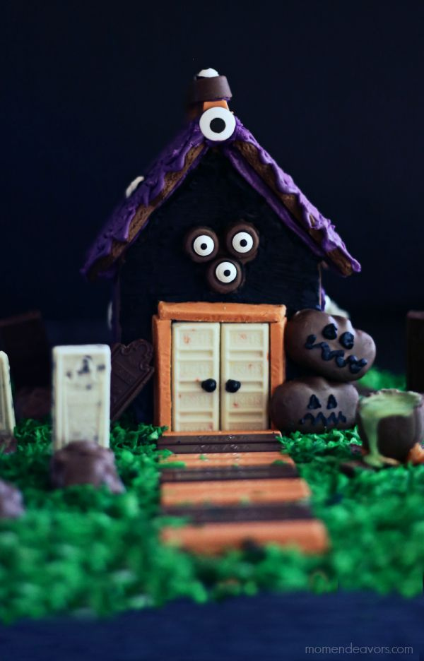 How to DIY a haunted gingerbread house: Our favorite tips |  We love the creative use of candies at this house by Mom Endeavors