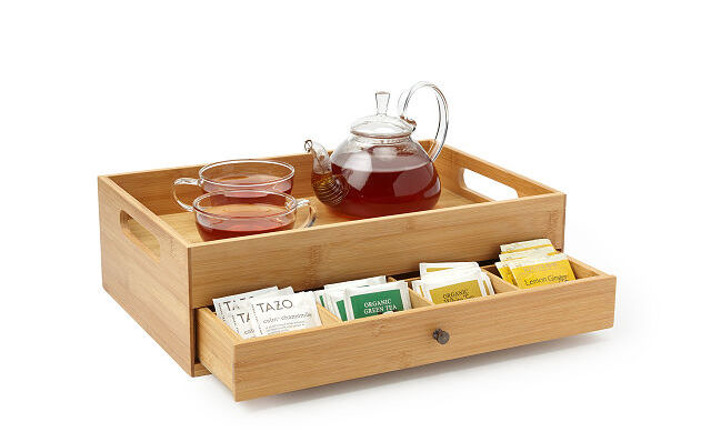 Gifts for The Crown fans: A lovely tea tray and storage set, from Uncommon Goods. Filled with their favorite British teas, of course.