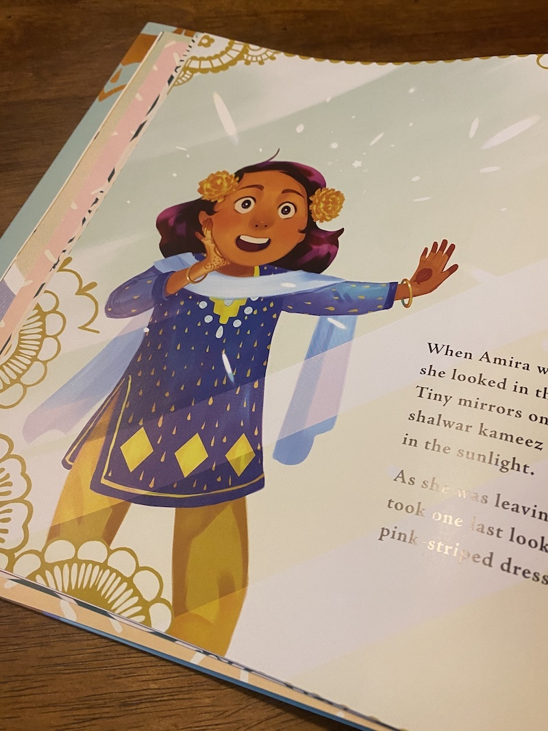 Amira's new clothes for Eid are so special, in Amira's Picture Day, a children's book about Eid
