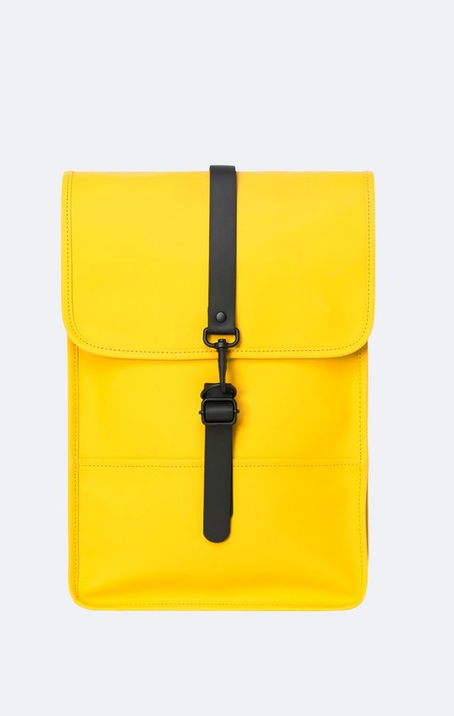 Cute summer backpacks: Rains Waterproof Mini Backpack is perfect for a laptop in Pantone's Illuminating Yellow color of 2021