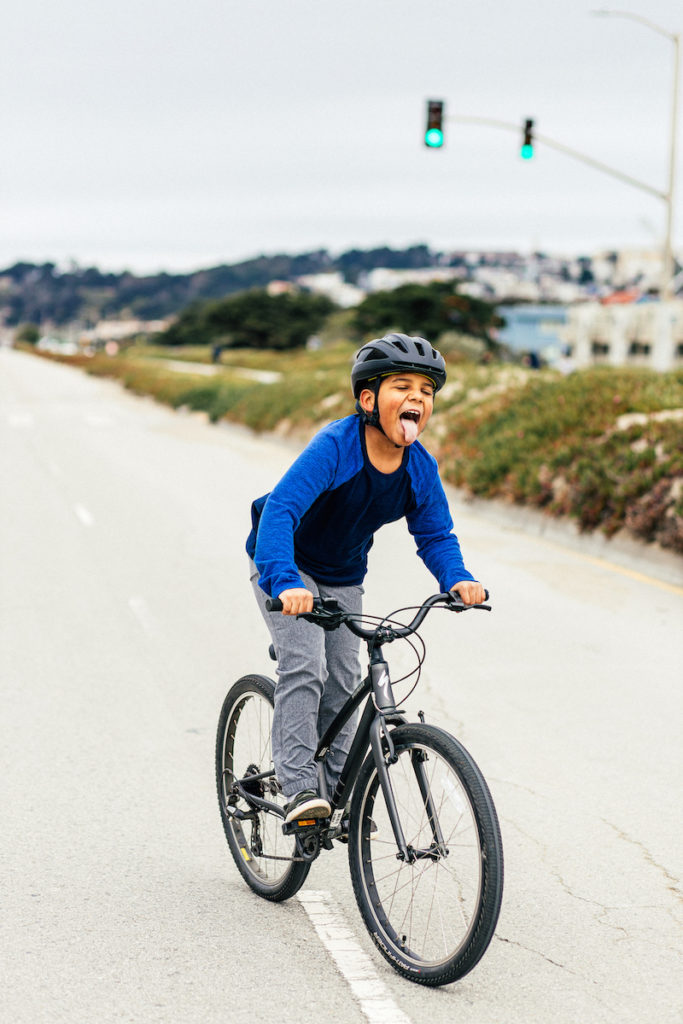 Riding on the new Specialized Jett Bicycle which can be adjustable to grow with kids