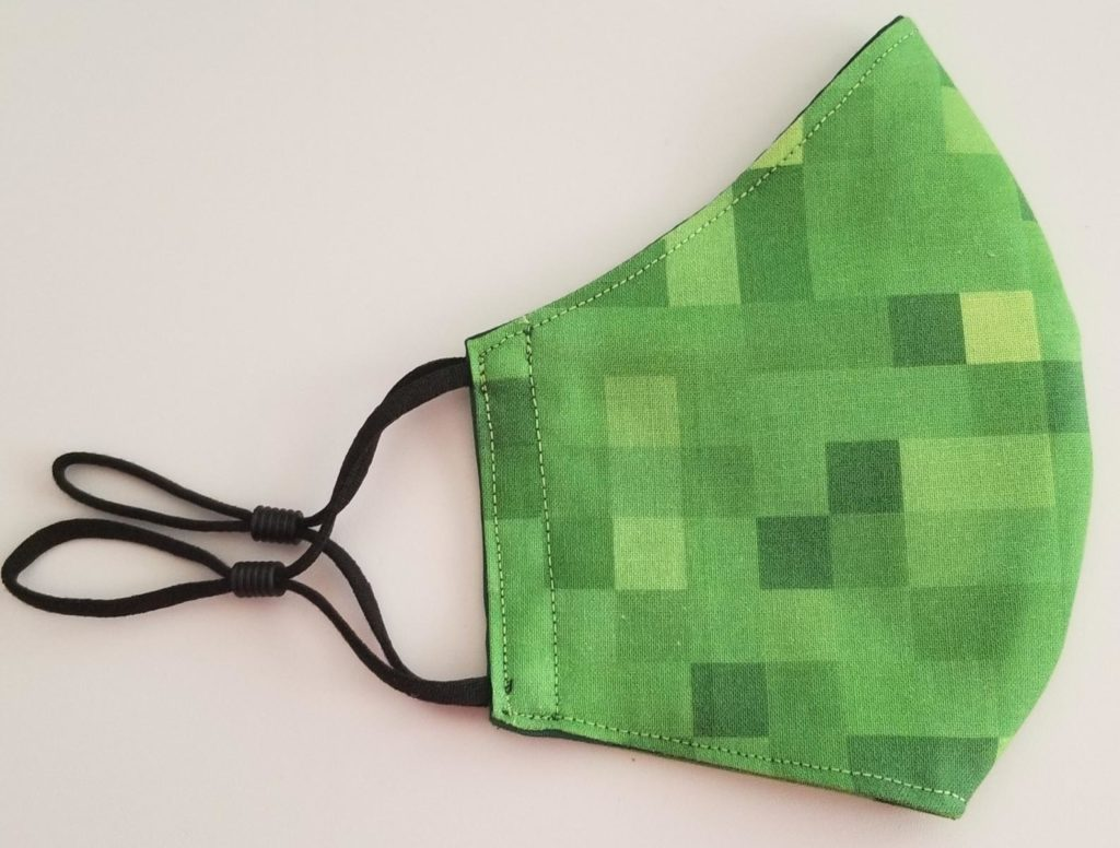 Camp care package ideas for tweens and teens: A new face mask like this handmade Minecraft face mask