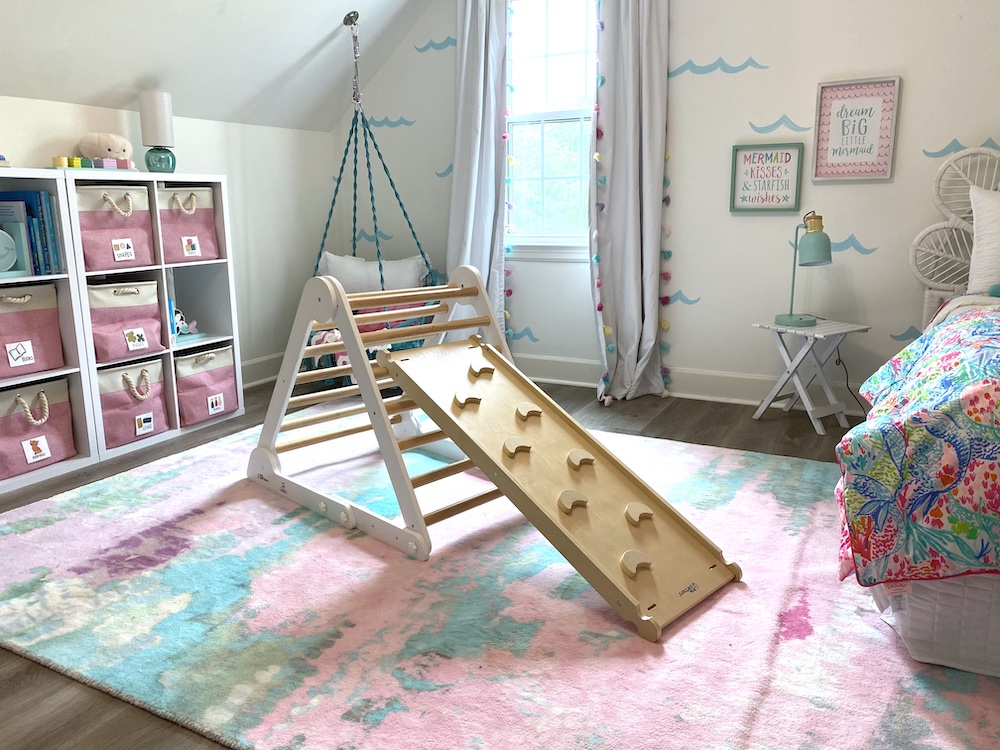 The Little Partners play gym is great for PT sessions in this room makeover for adopted kids by Bloom Family Designs.